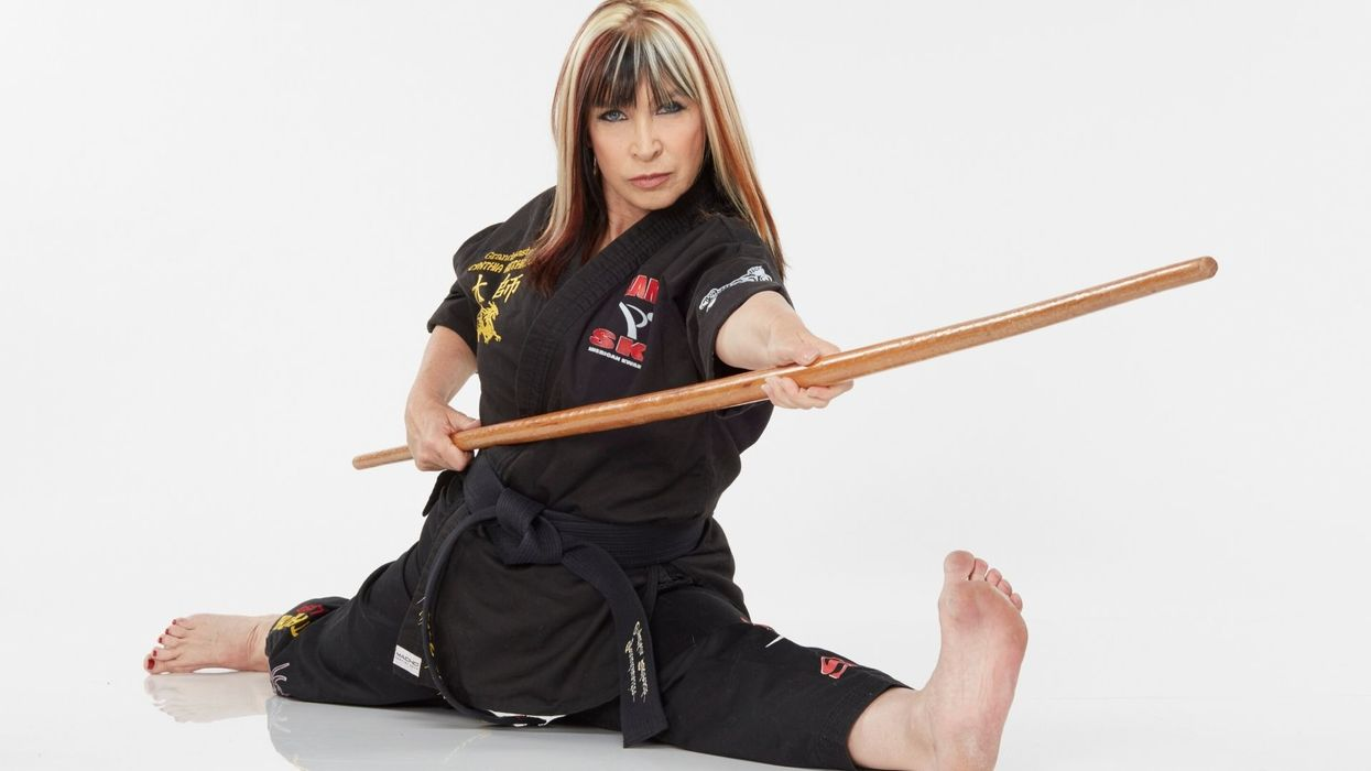 Cynthia Rothrock performing a form with a bo staff