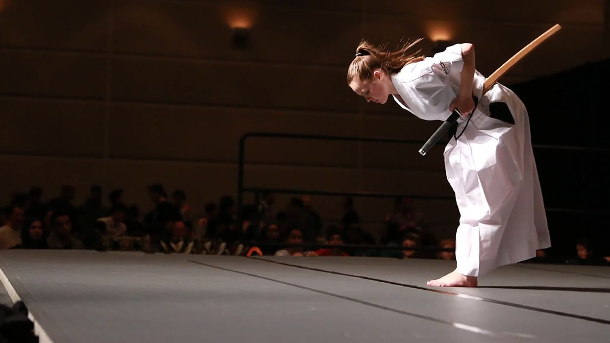 Mackensi Emory bows before performing a traditional sword routine